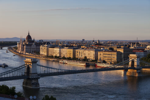 Hungary, Budapest, cityscape at sunset with Chain Bridge on Danube River - ABOF00317