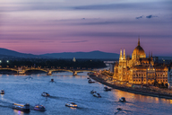 Hungary, Budapest, twilight at Danube River with lit up Hungarian Parliament building - ABOF00326