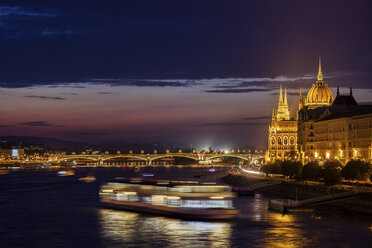 Hungary, Budapest, city by night, lights of passenger tour boat and Margaret Bridge on Danube River - ABOF00332