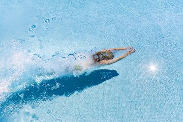 Spain, woman diving in swimming pool - SMAF00845