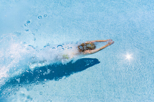 Spain, woman diving in swimming pool - SMAF00845
