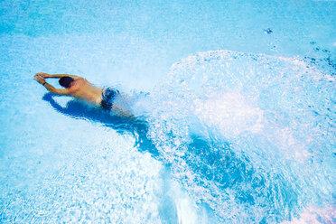 Spain, man diving in swimming pool - SMAF00857