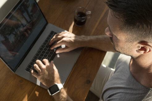 Mature man working on laptop, close-up - SBOF00881