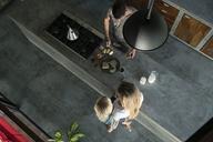 Family preparing healthy breakfast in comfortable kitchen - SBOF00890