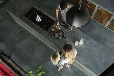 Family preparing healthy breakfast in comfortable kitchen - SBOF00890