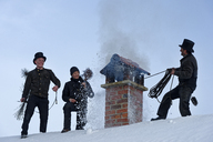 Three chimney sweeps working on roof top - LBF01705