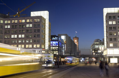 Germany, Berlin, Berlin-Mitte, Alexanderplatz, World clock, Red town hall and commuter line at night - BFR01808