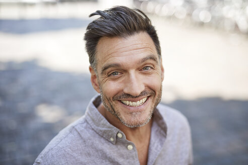 Portrait of laughing mature man with stubble - PNEF00320