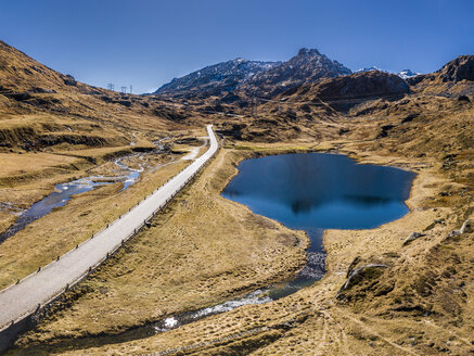 Switzerland, Canton of Uri, Tremola, Aerial view of Gotthard Pass and lake - STSF01384
