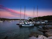 Croatia, Damlatia, Brac Island, marina at dusk - AMF05510