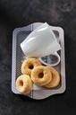 Five mini doughnutsand a coffee cup on tray - CSF28504