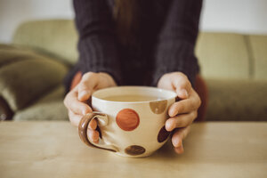 Woman's hands holding tea cup, close-up - JSCF00014