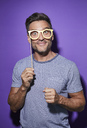 Portrait of starring man with comedy glasses - PNEF00333