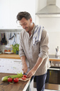 Man chopping vegetables in the kitchen - PNEF00345