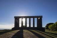 Great Britain, Scotland, Edinburgh, Calton Hill, National Monument of Scotland against the sun - FOF09527