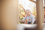 Portrait of happy baby girl on playground - DIGF03202