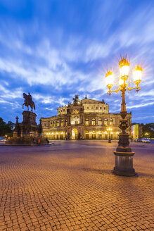 Germany, Dresden, Semper opera house with equestrian statue at  blue hour - WDF04190