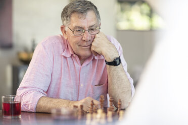 Senior couple playing chess at home - ZEF14757