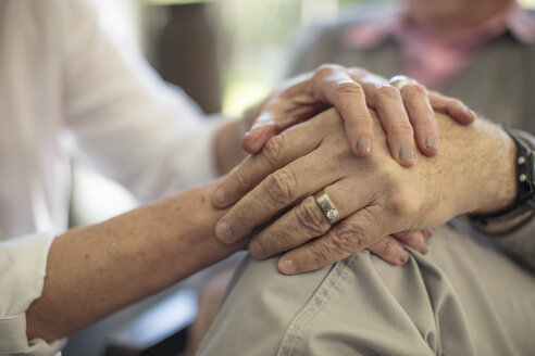 Close-up of senior couple holding hands - ZEF14769