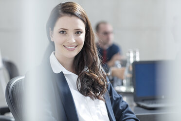 Portrait of smiling businesswoman on a meeting in conference room - ZEF14799