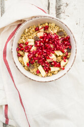 Bowl of fruit muesli with dried cranberries, apple and pomegranate seed - LVF06411