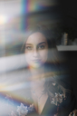 Portrait of woman behind windowpane - ALBF00246