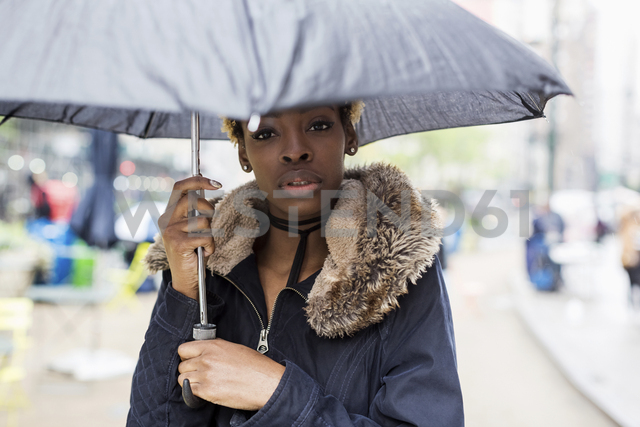 Portrait of young woman with umbrella - MAUF01224