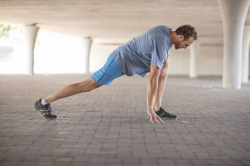 Sportive man stretching before exercising - ZEF14831
