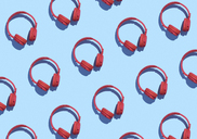 Collection of red wireless headphones on light blue background, 3D Rendering - DRBF00036