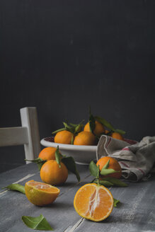 Sliced and whole tangerines on  wooden table - ODF01576