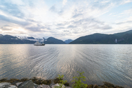 Norway, Sogn og Fjordane, Sognefjord, ferry during midnight sun - CSTF01497