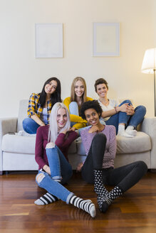 Portrait of group of female friends in living room - GIOF03423
