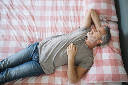 Relaxed mature man lying on bed - ALBF00275