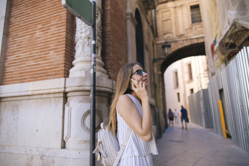 Spain, Valencia, woman on the phone on the city - JPF00293