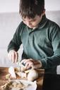 Boy chopping pear - ALBF00300
