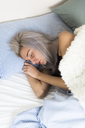 Young woman sleeping in bed - GIOF03470