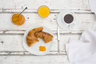 Croissant breakfast, apricot jam, cup of coffee and orange juice - LVF06426