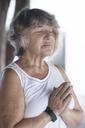 Senior woman doing a yoga exercise - ABAF02192