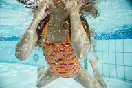 Girl under water in swimming pool - MFF04169