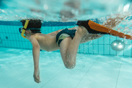 Boy with diving goggles, flippers and snorkel under water in swimming pool - MFF04181