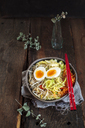 Bowl of glutenfree Udon noodle soup with carrots, Chinese cabbage, zoodles, mungo beans sprouts and boiled egg - SBDF03385