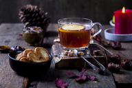 Glass of black tea with slice of lemon and rock sugar on wooden table - SBDF03387
