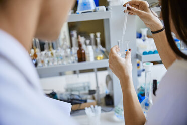 Young woman pipetting in laboratory - ZEDF01017