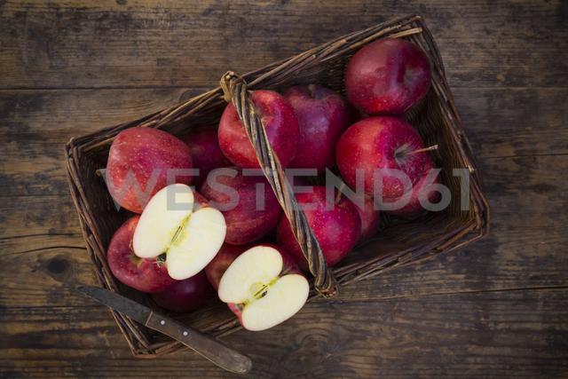 Red apples in basket, knife - LVF06427