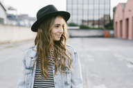 Portrait of fashionable young woman wearing hat - GIOF03523