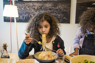Little girl eating tasty spaghetti - MOEF00313