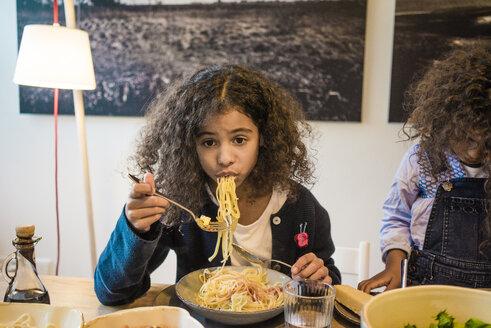Little girl eating tasty spaghetti - MOEF00313