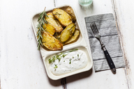 Bowl of potato wedges with rosemary and herbed curd cheese - SBDF03392