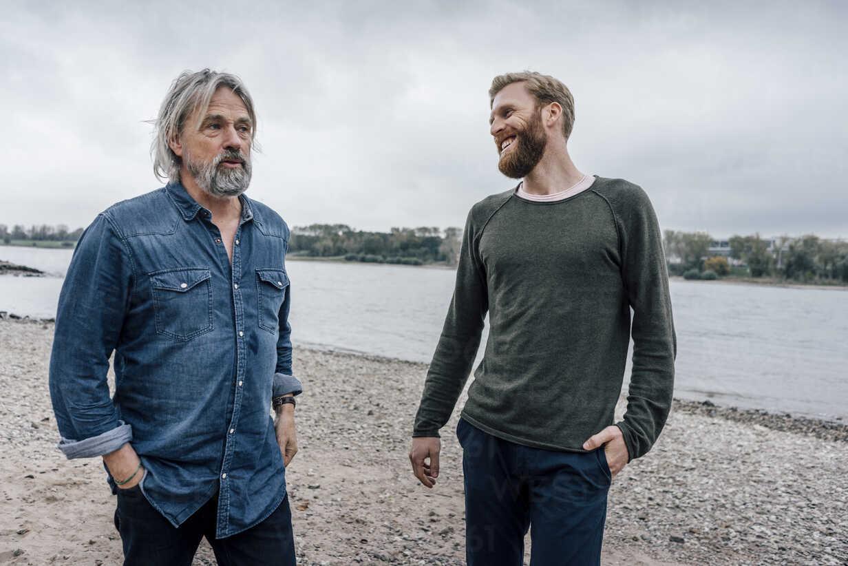 Father and son taking a stroll at Rhine river, meeting to talk - KNSF02906 - Kniel Synnatzschke/Westend61