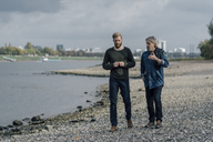 Father and son taking a stroll at Rhine river, meeting to talk - KNSF02933
